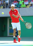 Professional tennis player Kei Nishikori of Japan in action during his men`s singles semifinal match of the Rio 2016 Olympic Games Royalty Free Stock Image