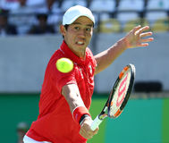Professional tennis player Kei Nishikori of Japan in action during his men`s singles semifinal match of the Rio 2016 Olympic Games Stock Photography