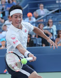 Professional tennis player Kei Nishikori of Japan in action during his round four match at US Open 2016 Royalty Free Stock Photo