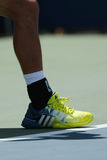 Professional tennis player Kei Nishikori of Japan wears custom Adidas tennis shoes during match at US Open 2016 Stock Photos