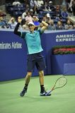 Professional tennis player Kevin Andersen of South Africa celebrates victory after his US Open 2017 semifinal match. NEW YORK  - SEPTEMBER 8, 2017: Professional Royalty Free Stock Photos