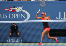 Professional tennis player Kristina Mladenovic of France in action during her US Open 2015 match. NEW YORK - SEPTEMBER 8, 2015: Professional tennis player Stock Photos