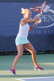 Professional tennis player Lesia Tsurenko from Ukraine during US Open 2014 qualifying match. NEW YORK - AUGUST 19, 2014: Professional tennis player Lesia Stock Photography