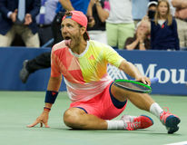 Professional tennis player Lukas Poulle of France celebrates victory over Rafael Nadal after round three match at US Open 2016 Royalty Free Stock Images