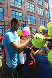 Professional tennis player Marin Cilici signing autographs after practice for US Open 2014 Royalty Free Stock Images