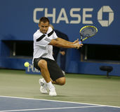 Professional tennis player Mikhail Youzhny during  quarterfinal match at US Open 2013 against  Novak Djokovic Stock Image