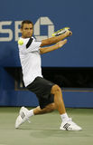 Professional tennis player Mikhail Youzhny during  quarterfinal match at US Open 2013 against  Novak Djokovic Stock Photography
