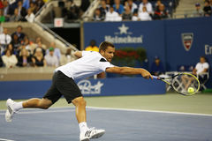 Professional tennis player Mikhail Youzhny during  quarterfinal match at US Open 2013 against  Novak Djokovic Royalty Free Stock Image