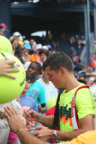 Professional tennis player Miols Raonic signing autographs after third round match at US Open 2014 Stock Images