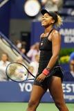 Professional tennis player Naomi Osaka celebrates victory after 2018 US Open semi-final match stock photos