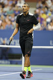 Professional tennis player Nick Kyrgios of Australia in action during his first round match at US Open 2015 Royalty Free Stock Images