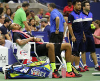 Professional tennis player Nick Kyrgios of Australia resting during his first round match at US Open 2015 Stock Images