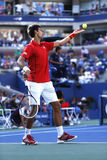 Professional tennis player Novak Djokovic during  fourth round match at US Open 2013 against Marcel Granollers Royalty Free Stock Image