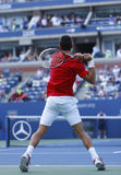 Professional tennis player Novak Djokovic during  fourth round match at US Open 2013 Stock Photo