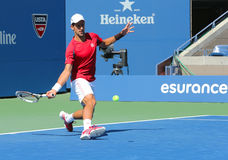 Professional tennis player Novak Djokovic practices for US Open 2013 Stock Image