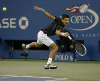 Professional tennis player Novak Djokovic during  quarterfinal match at US Open 2013 against Mikhail Youzhny Royalty Free Stock Photos