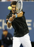 Professional tennis player Novak Djokovic during  quarterfinal match at US Open 2013 against Mikhail Youzhny Royalty Free Stock Images