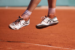 Professional tennis player Richard Gasquet of France wears custom Asics Gel Resolution shoes during his third round match at Rola Royalty Free Stock Photos