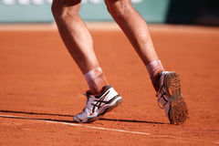 Professional tennis player Richard Gasquet of France wears custom Asics Gel Resolution shoes during his third round match at Rola Royalty Free Stock Images