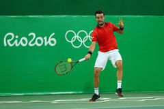 Professional tennis player Roberto Bautista Agut of Spain in action during men`s quarter final of the Rio 2016 Olympic Games Stock Image
