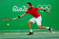 Professional tennis player Roberto Bautista Agut of Spain in action during men`s quarter final of the Rio 2016 Olympic Games Royalty Free Stock Photo