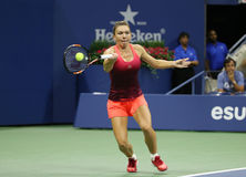 Professional tennis player Simona Halep of Romania in action during her third round match at US Open 2015 Royalty Free Stock Image
