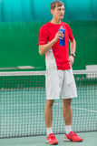 Professional tennis player standing Stock Images