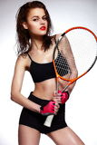 Professional tennis player woman model with bright Stock Photo