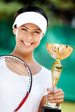Professional tennis player won the competition. Successful tennis player won the cup at the sport competition. Victory Royalty Free Stock Photos