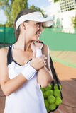 Professional Tennis Woman With Mesh tennis Bag at Court Royalty Free Stock Photos