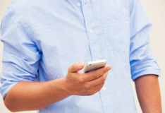 Professional texting on cell phone Stock Images