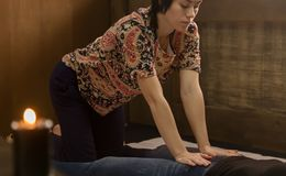 Professional therapist giving traditional Thai massage or Thai yoga massage treatment.  Stock Photography