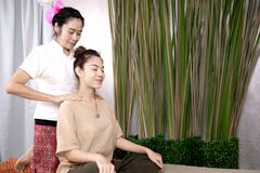 Professional therapist giving traditional thai massage to a woma Royalty Free Stock Photography