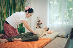 Professional therapist giving traditional thai massage to a woma Royalty Free Stock Image