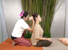 Professional therapist giving traditional thai massage to a woma Royalty Free Stock Photos