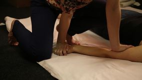 Professional therapist giving traditional Thai massage or Thai yoga massage treatment stock video