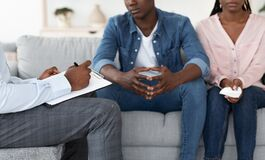 Free Professional Therapist Taking Notes At Marital Therapy Session With Upset Black Couple Stock Photos - 195578103