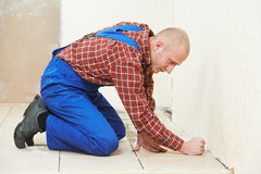Tiler at home floor tiling renovation work Royalty Free Stock Photo