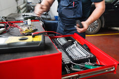 Professional toolbox with modern tools at garage. Mechanic taking facilities from special box for mechanical instruments Royalty Free Stock Images