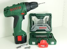A professional tools of Bosch - one green cordless drill accumulator drill and a set of drill bits. Bahno/Czech Republic - May 8, 2018: A professional tools of royalty free stock image