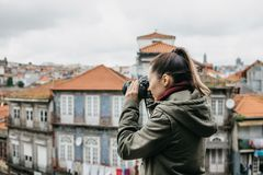 A professional travel photographer or tourist photographs a beautiful cityscape in Porto in Portugal. Professional. A professional travel photographer or tourist stock images