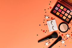 Professional trendy makeup products with cosmetic beauty products,  eye shadows, eye lashes, brushes and tools. Space for text or. Design. Top view stock images