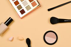 Professional trendy makeup products with cosmetic beauty products, foundation, lipstick,  eye shadows, eye lashes, brushes and. Tools. Top view stock photography