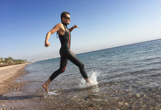 Professional triathlete practicing in open water. Plunge in sea. Royalty Free Stock Photos
