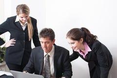 Professional Trio at work Royalty Free Stock Photos