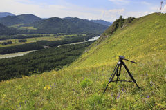Professional tripod with videography on top of the mountain. Altai Stock Images