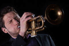 Professional trumpet player. Isolated on black background Stock Photo