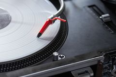 Professional turntable playing vinyl record. Top-class spherical needle on professional turntable vinyl record player Stock Image