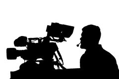 Professional TV cameraman with headphones silhouette. Stock Photography