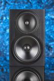 Professional two way audio speaker on blue defocused background Royalty Free Stock Photos